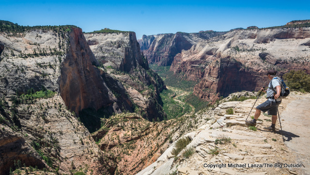 A hiker at Observation Point in Zion National Park.