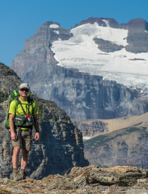 Michael Lanza of The Big Outside backpacking the Redgap Pass Trail in Glacier National Park.