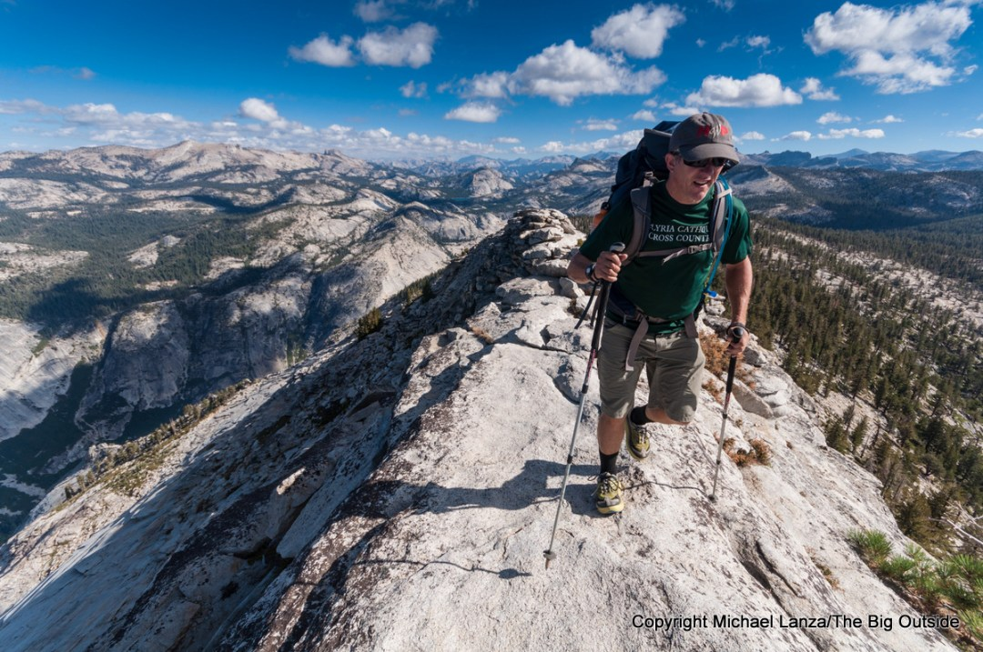 A backpacker hiking over Clouds Rest in Yosemite National Park.