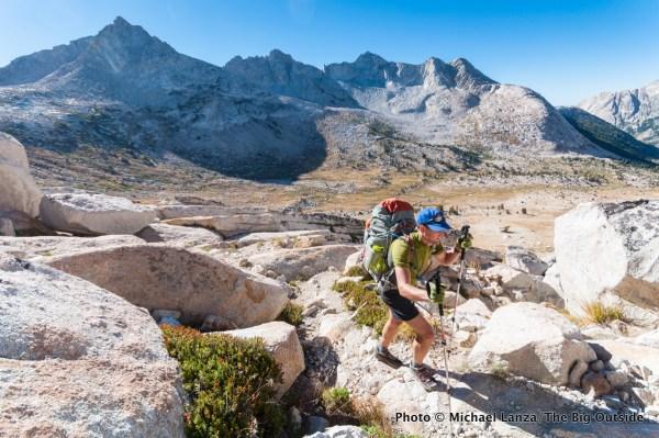 A backpacker hiking to Burro Pass above Matterhorn Canyon, Yosemite National Park.