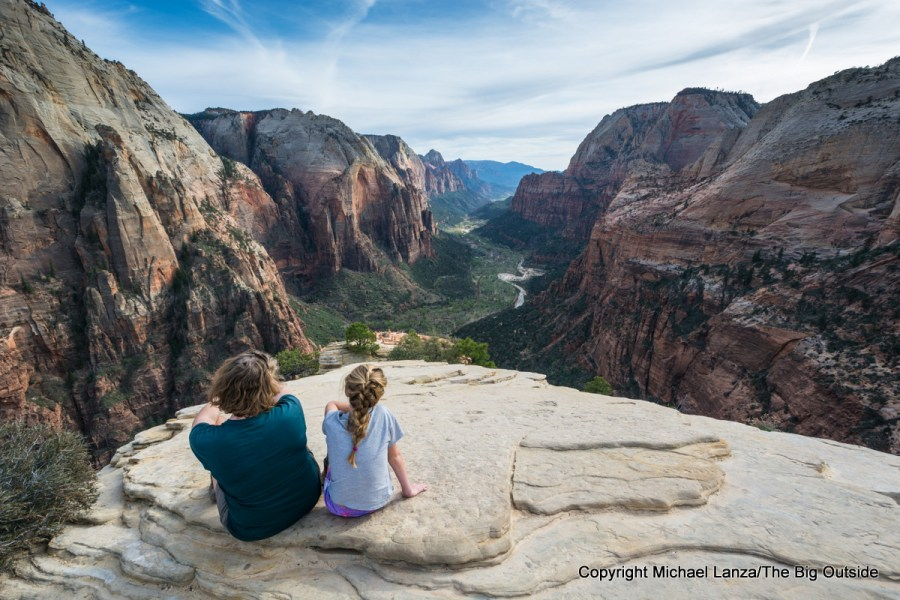 A woman and girl at the summit of Angels Landing in Zion National Park.
