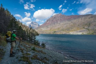 A backpacker on the St. Mary Lake Trail, Glacier National Park.