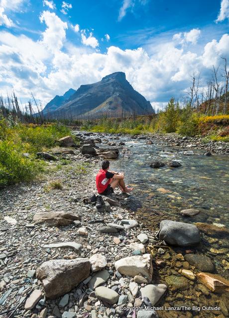 A backpacker in Red Eagle Creek, Glacier National Park.