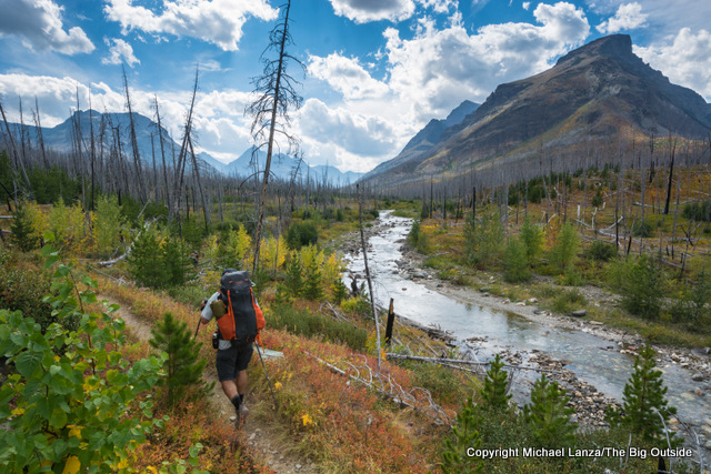 A backpacker in the Redgap Creek Valley of Glacier National Park.
