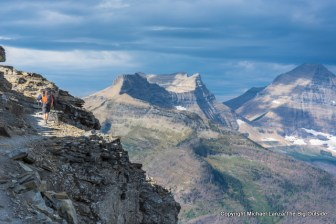 A backpacker on the Dawson Pass Trail in Glacier National Park.