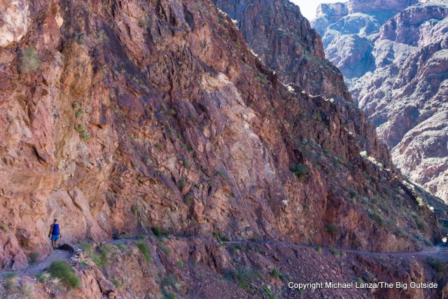 A hiker on the lower Bright Angel Trail in the Grand Canyon.
