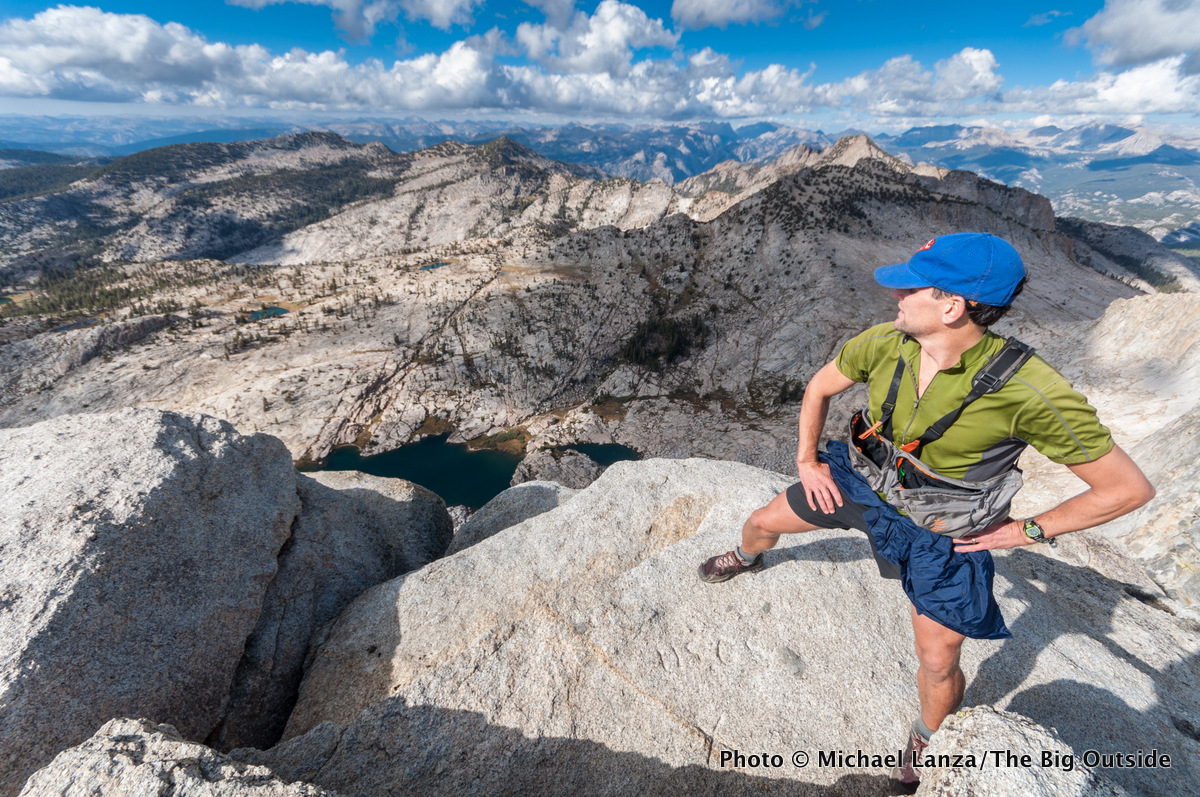 A hiker on the summit of Mount Hoffmann, Yosemite National Park.