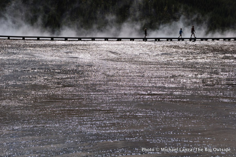 Hikers at Grand Prismatic Spring in the Midway Geyser Basin, Yellowstone National Park.