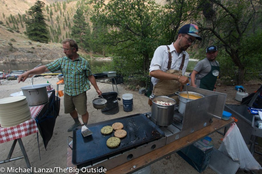 Middle Fork Rapid Transit guides cooking dinner on Idaho's Middle Fork Salmon River.