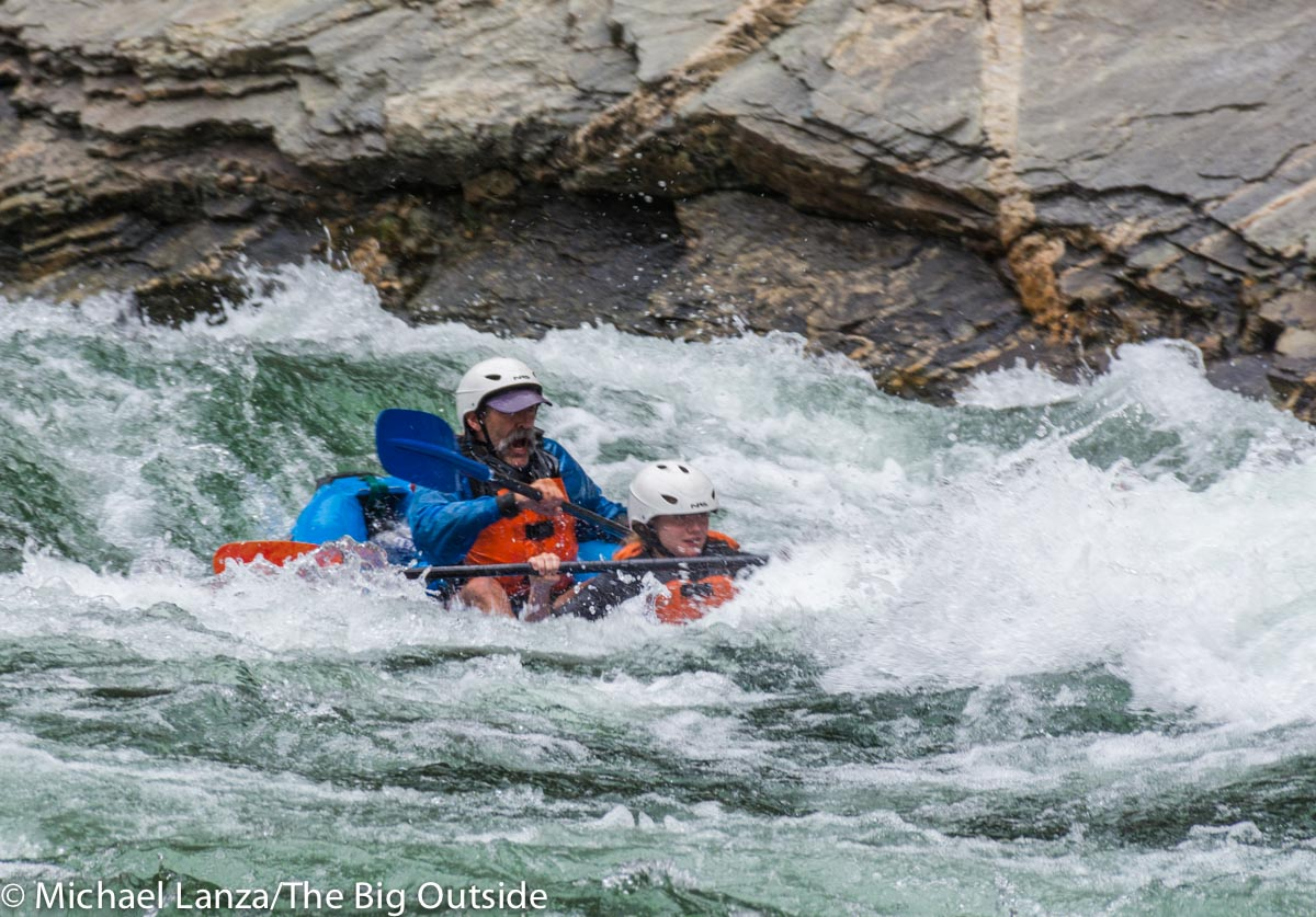 Two paddlers in an inflatable kayak in Cliffside Rapid on Idaho's Middle Fork Salmon River.