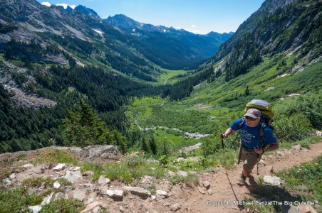 A backpacker hiking to Spider Gap in Washington's Glacier Peak Wilderness.