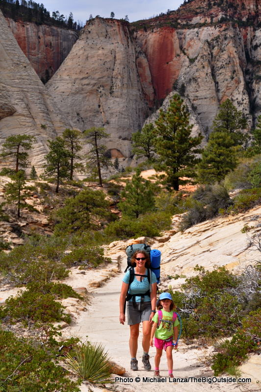 A mother and young daughter backpacking the West Rim Trail in Zion National Park.
