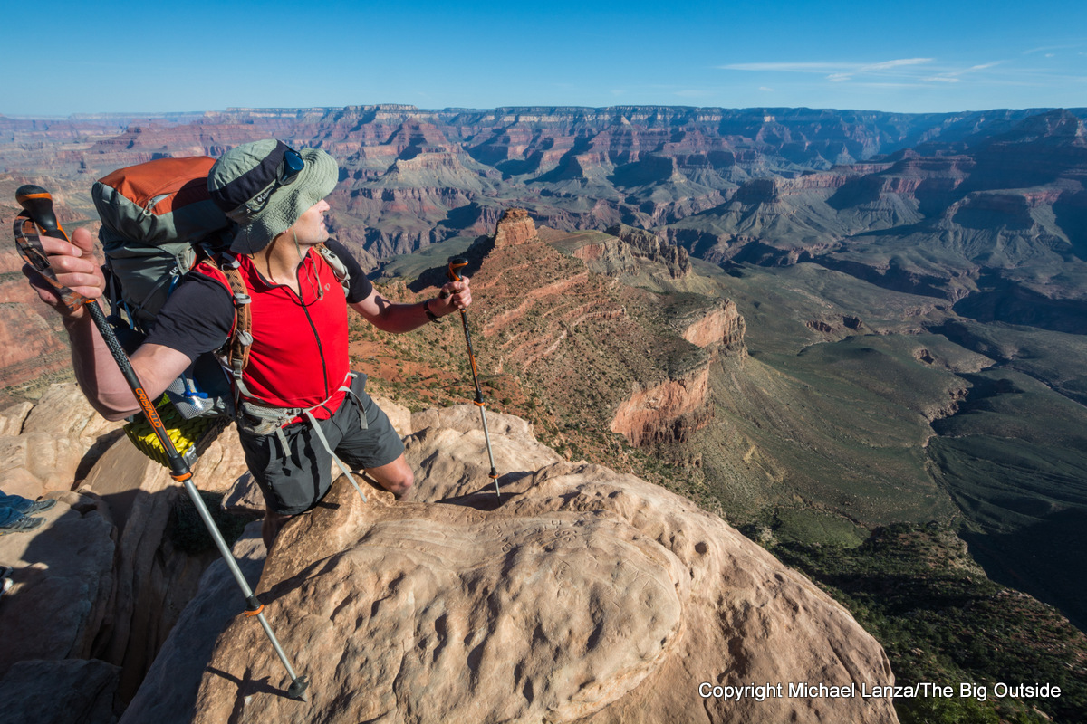 A backpacker at Ooh-Ah Point on the South Kaibab Trail in the Grand Canyon.