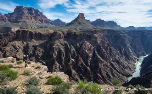 A backpacker on the Tonto Trail above the Colorado River in the Grand Canyon.