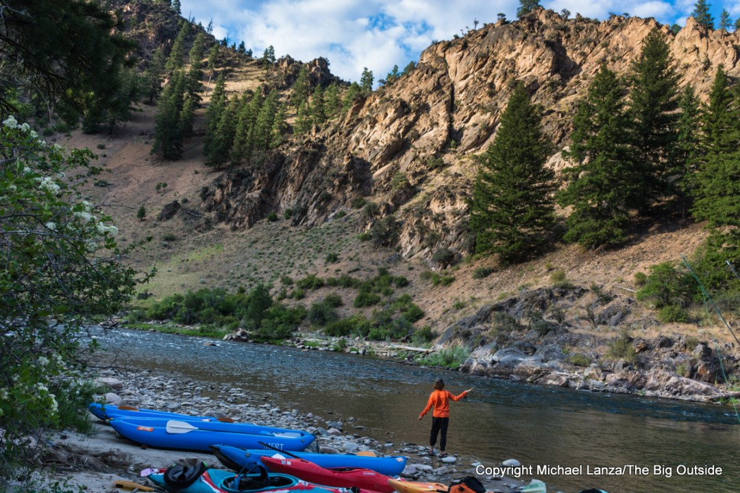 A young man fishing in Idaho's Middle Fork Salmon River.