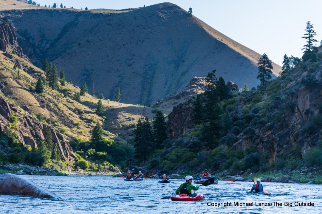 Kayakers and rafts in early morning on Idaho's Middle Fork Salmon River.