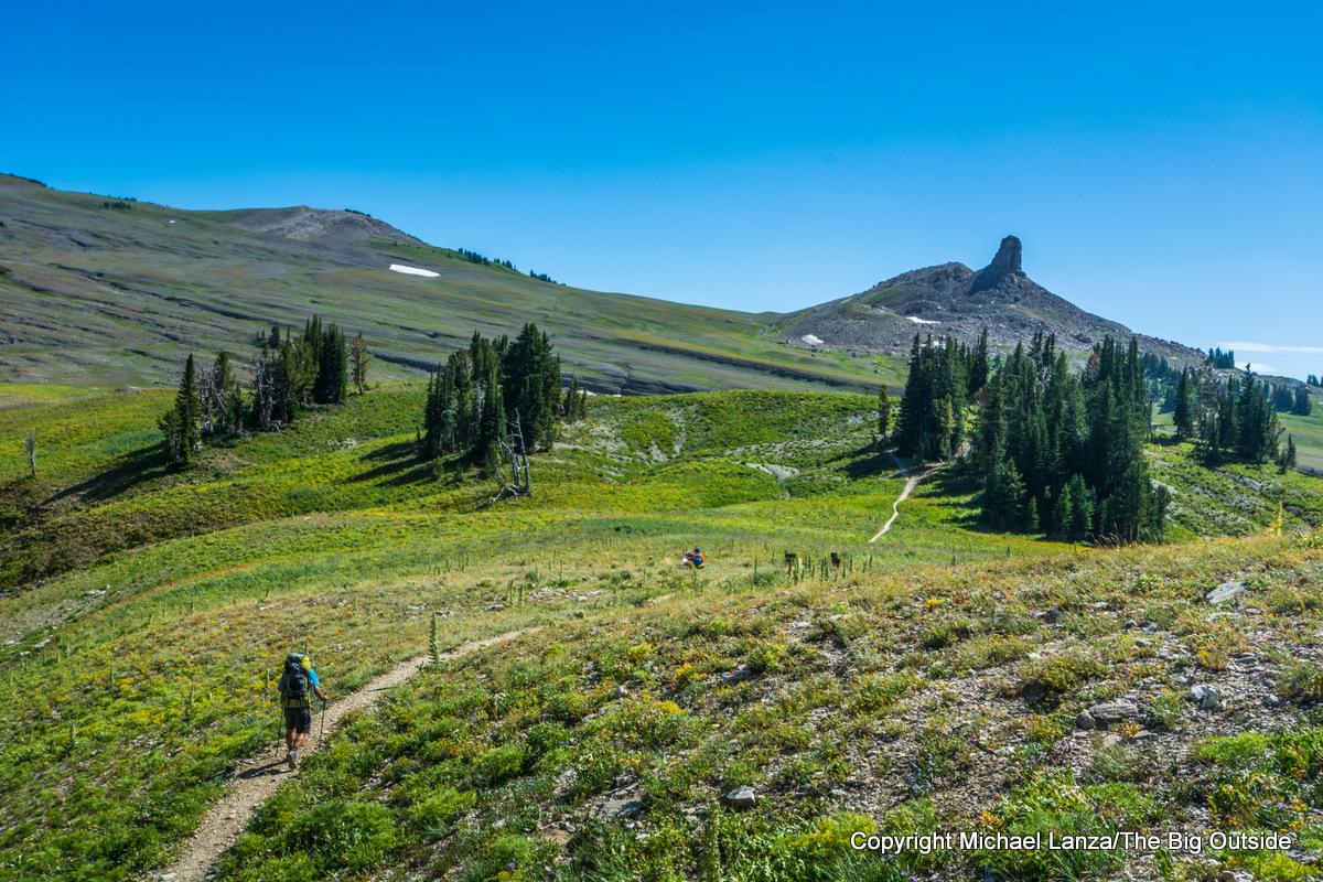 A backpacker hiking to Fox Creek Pass, Grand Teton National Park.