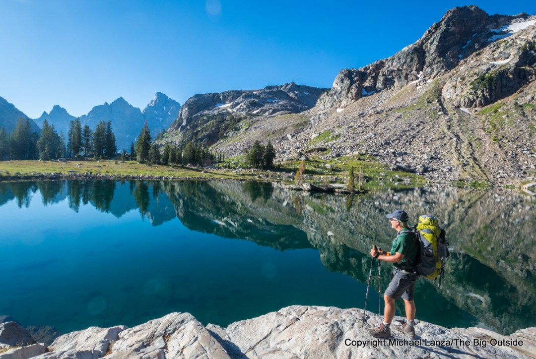 A backpacker at Lake Solitude on the Teton Crest Trail, Grand Teton National Park.