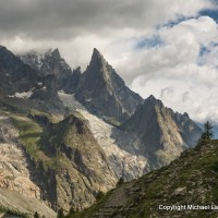 A family trekking the Tour du Mont Blanc in Italy.