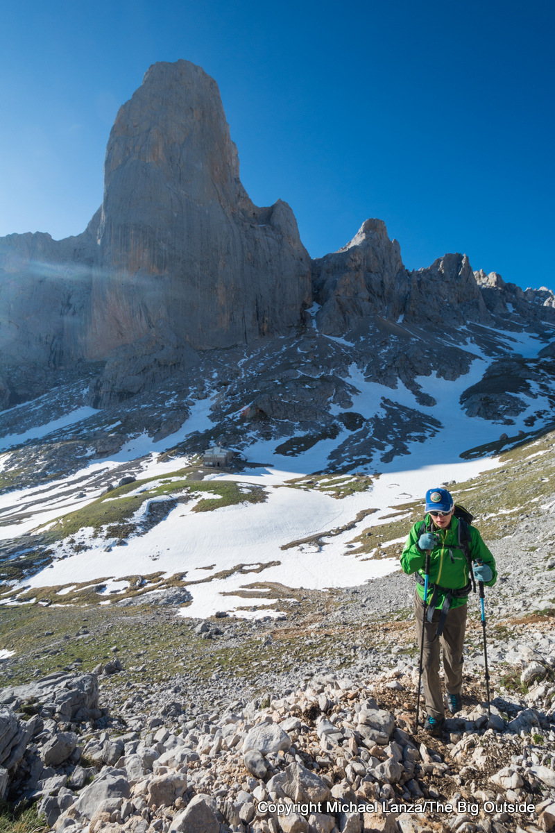 A hiker with the Naranjo de Bulnes peak in the background, in Spain's Picos de Europa National Park.