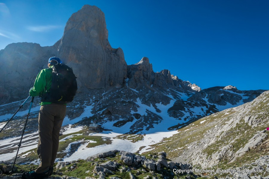 A hiker overlooking the Naranjo de Bulnes peak in Spain's Picos de Europa National Park.