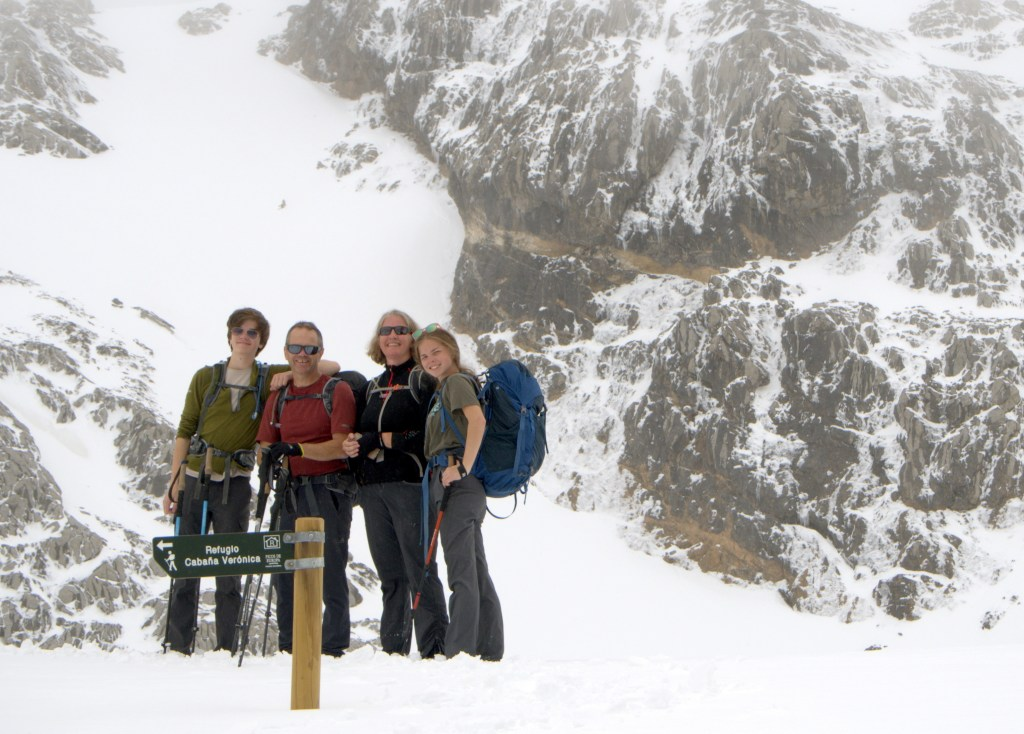 A family trekking through Spain's Picos de Europa National Park.