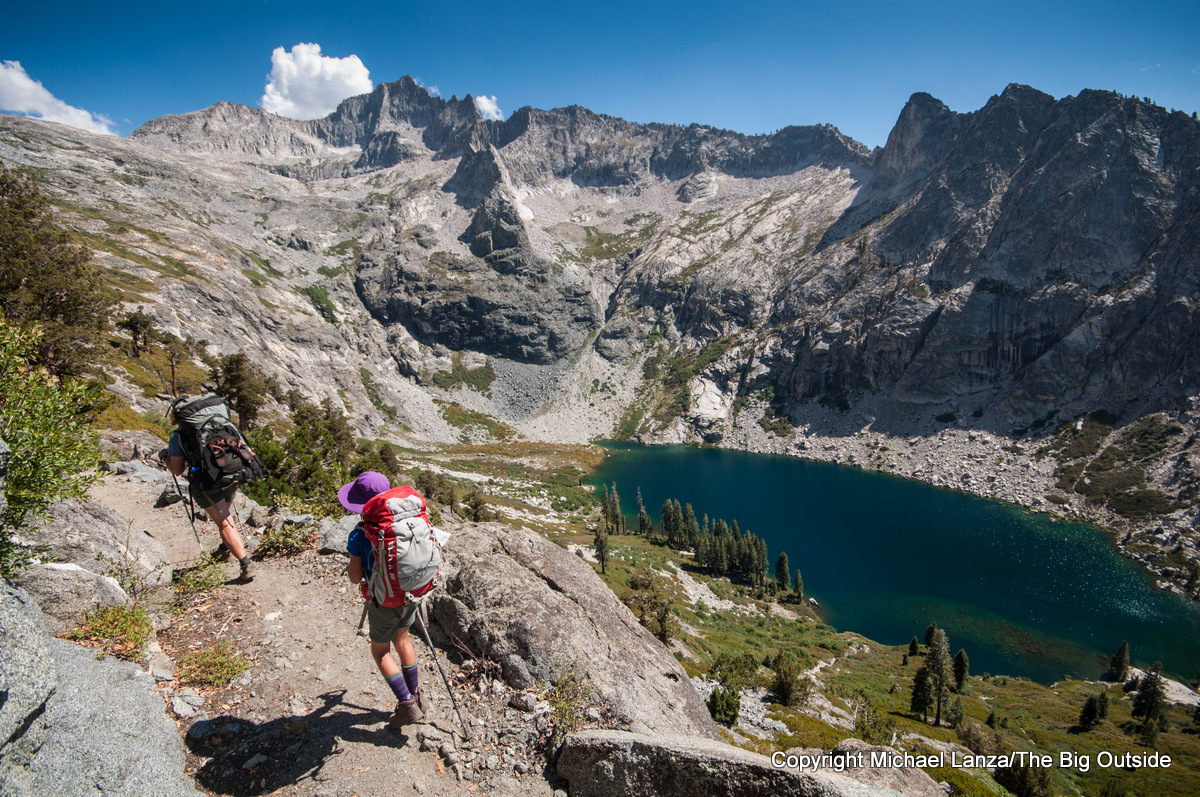 A mother and young daughter backpacking the High Sierra Trail above Hamilton Lakes, Sequoia National Park.