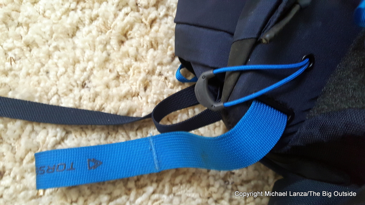 The North Face Banchee 50 Dyno Lite strap and tab.