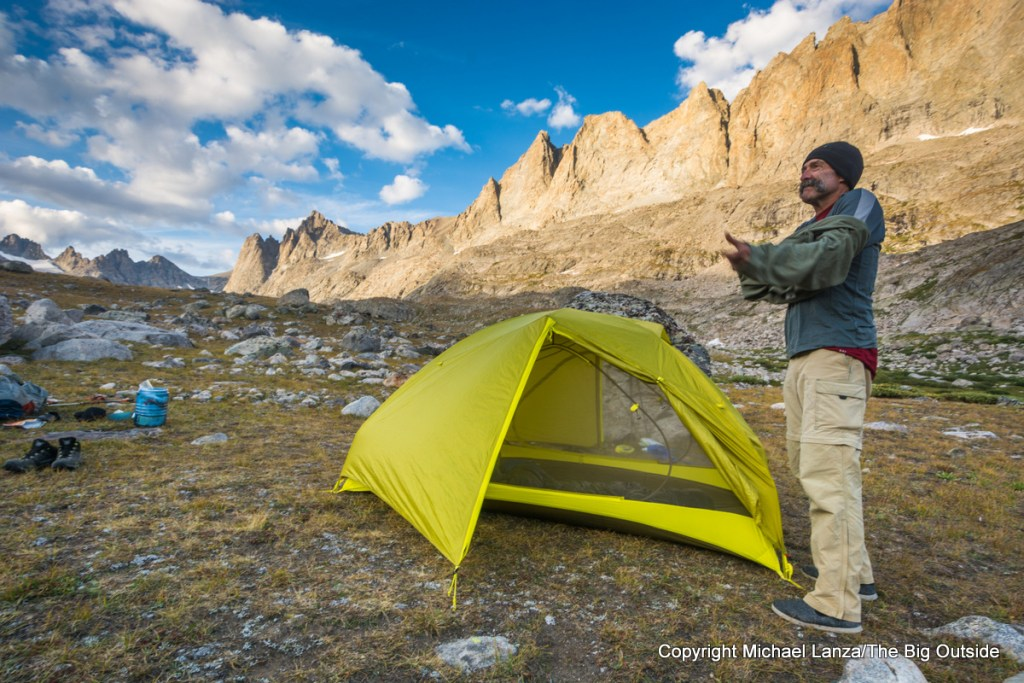 A backpacker at a campsite in Titcomb Basin, Wind River Range, Wyoming.