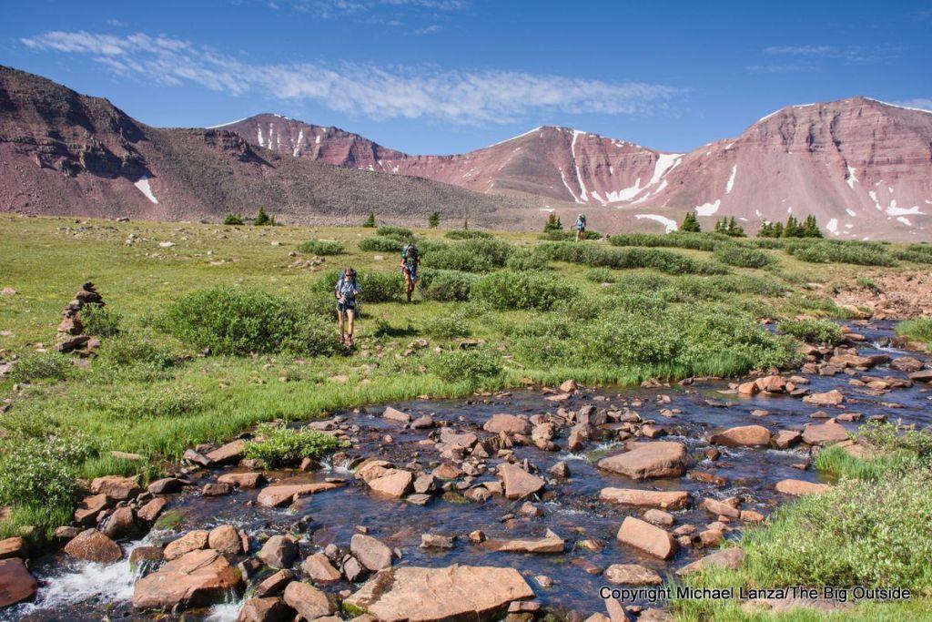 Teenage girls backpacking in Utah's High Uintas Wilderness.