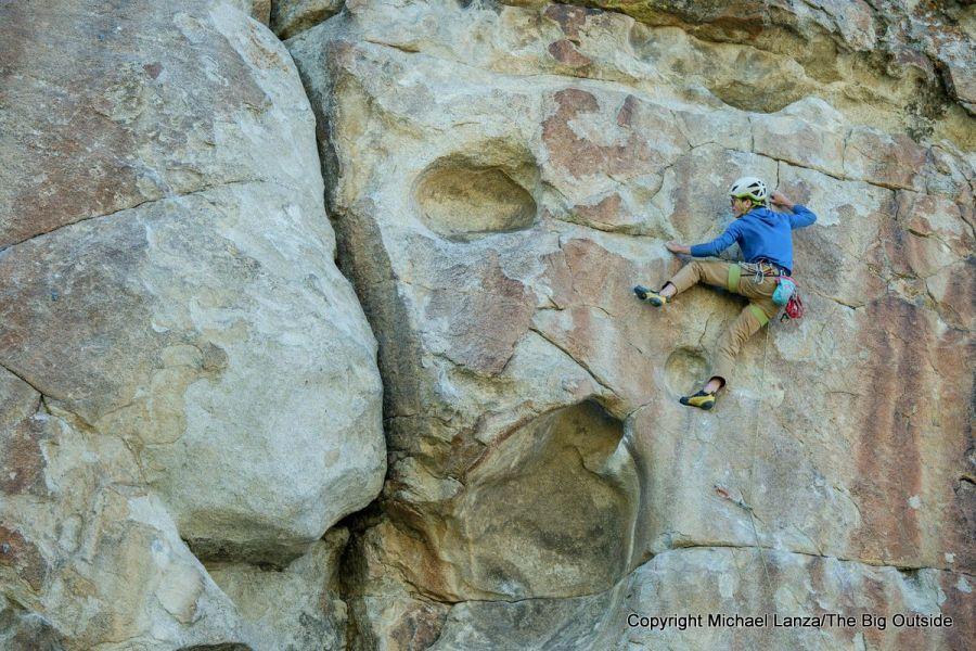 A young man rock climbing at Idaho's City of Rocks National Reserve.