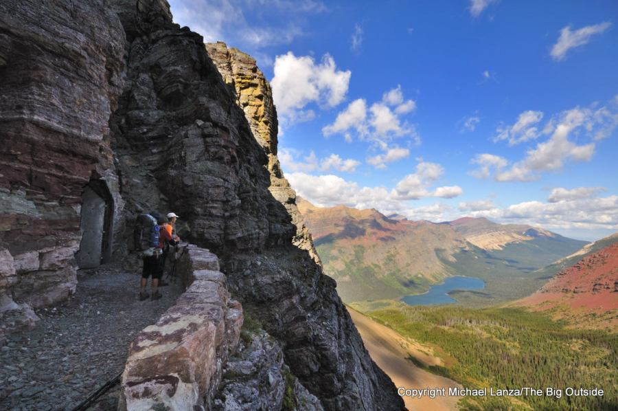 Backpackers on the Ptarmigan Tunnel Trail high above Elizabeth Lake in Glacier National Park.