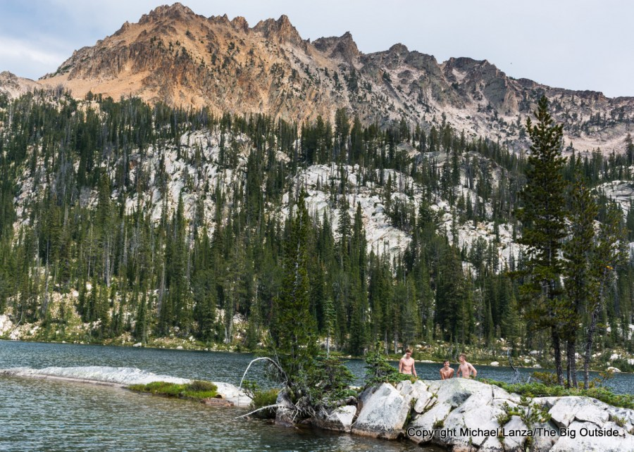 Teenage backpackers cooling off in Hidden Lake, Sawtooth Mountains, Idaho.