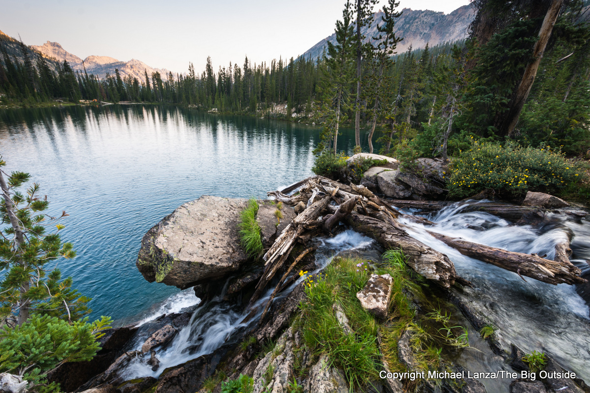 A waterfall and Middle Cramer Lake, Sawtooth Mountains, Idaho.