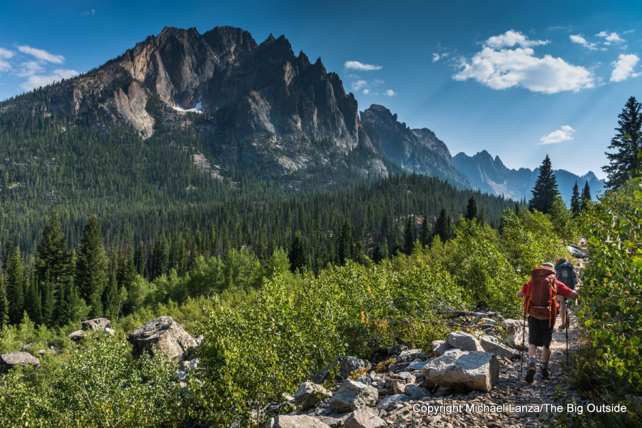 Backpackers hiking Trail 101 in Redfish Creek Valley, Sawtooth Mountains Idaho.