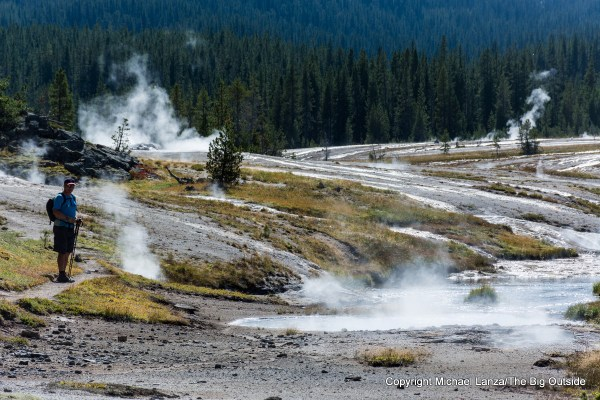 A hiker in the Shoshone Geyser Basin in Yellowstone National Park.