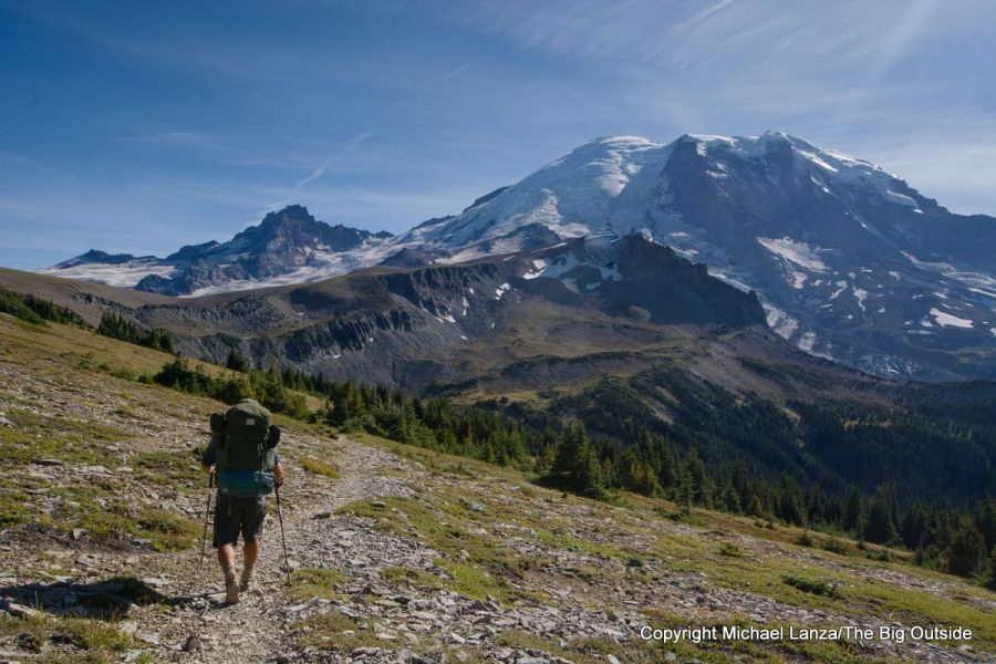 A backpacker descending toward Granite Creek on the Wonderland Trail in Mount Rainier National Park.
