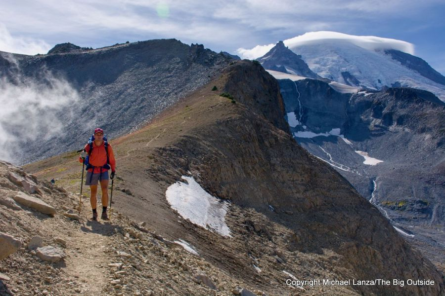 A backpacker at Panhandle Gap on the Wonderland Trail, Mount Rainier National Park.
