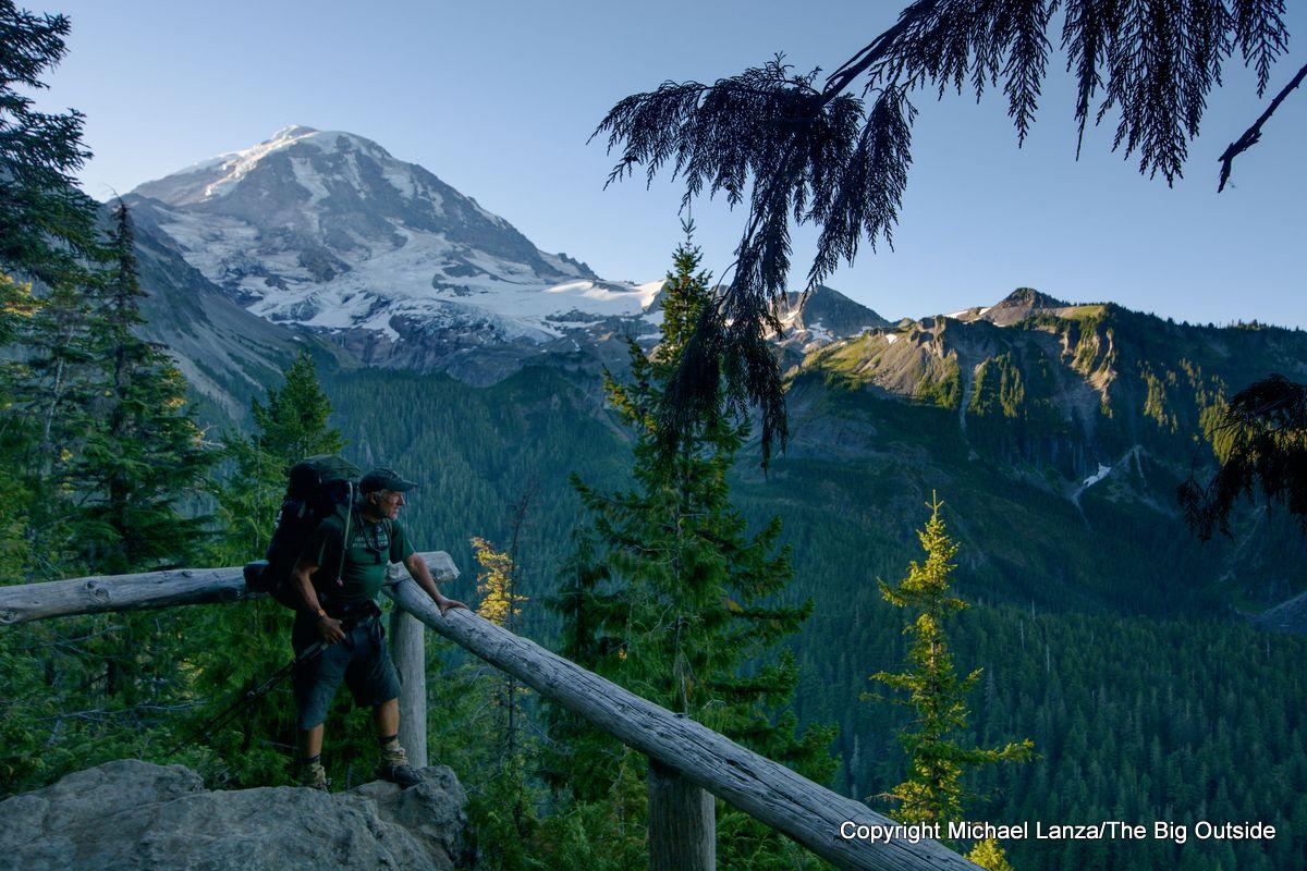 A backpacker at Eagle Cliff on the Spray Park Trail, Mount Rainier National Park.