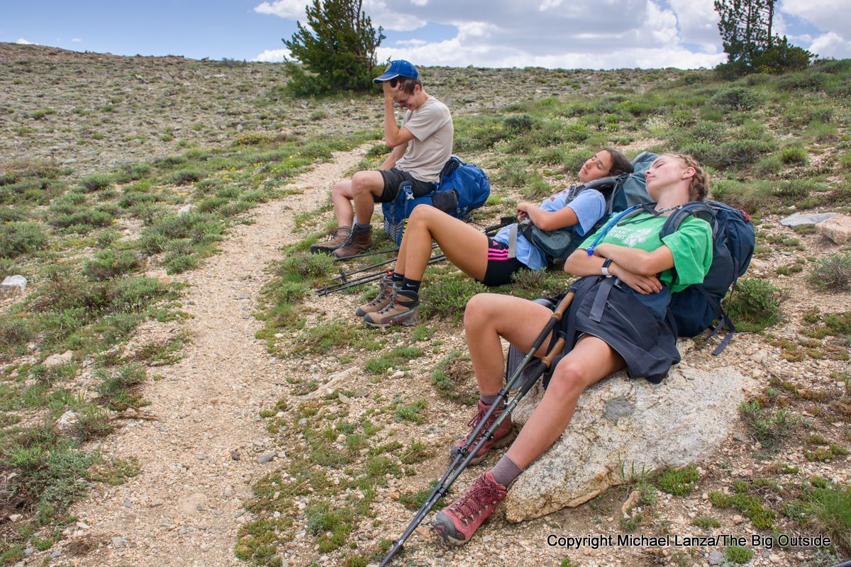 Tired teenage backpackers on the Ruby Crest Trail, day three, Ruby Mountains, Nevada.