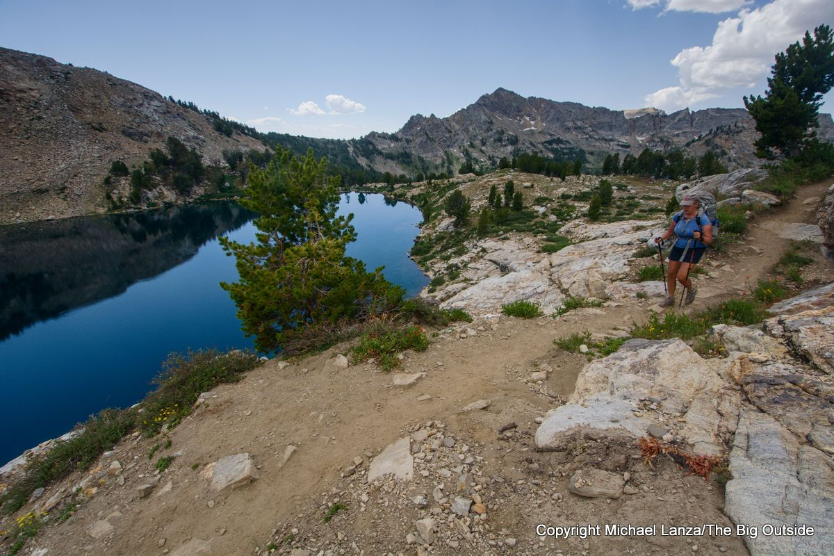 A backpacker passing Liberty Lake on the Ruby Crest Trail, Ruby Mountains, Nevada.