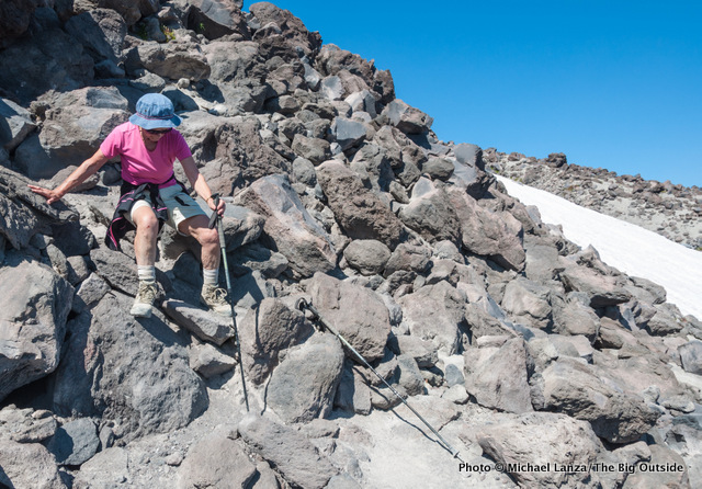 An elderly woman hiking down off Mount St. Helens.