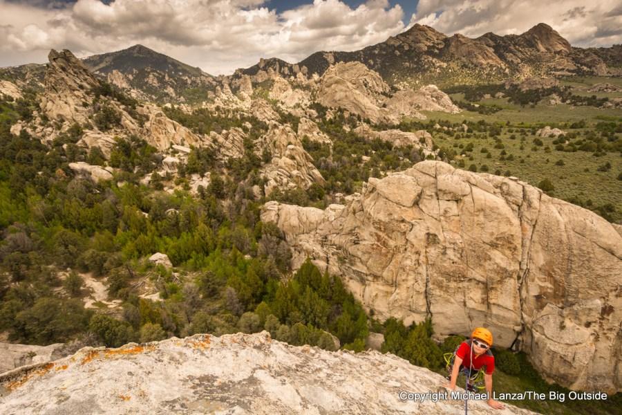 Teenage boy rock climbing the Lost Arrow Spire in Idaho's City of Rocks National Reserve.