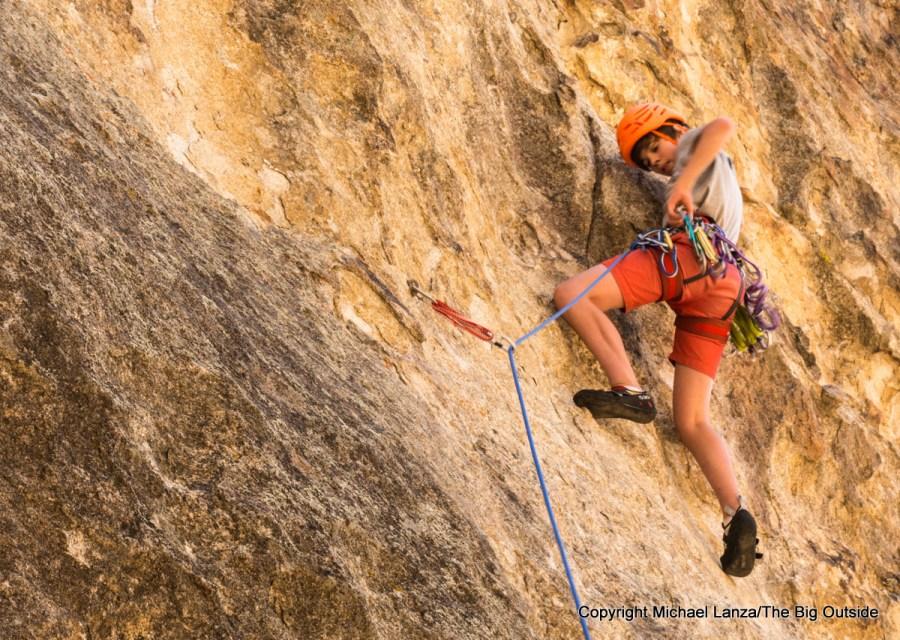 Teenage boy rock climbing at Idaho's City of Rocks National Reserve.