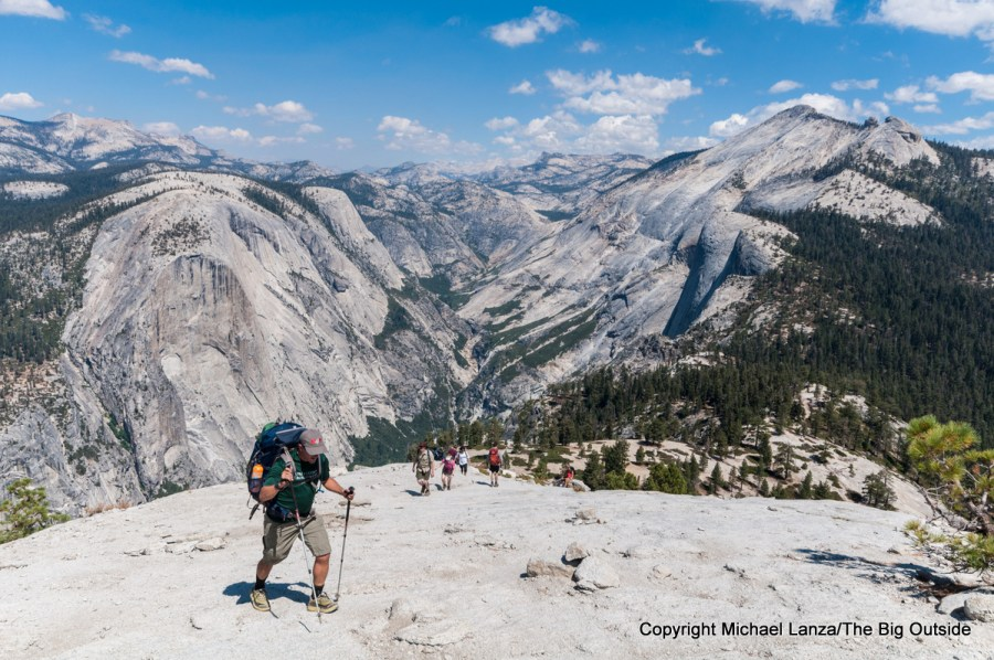 A backpacker hiking up the Half Dome Trail in Yosemite National Park.