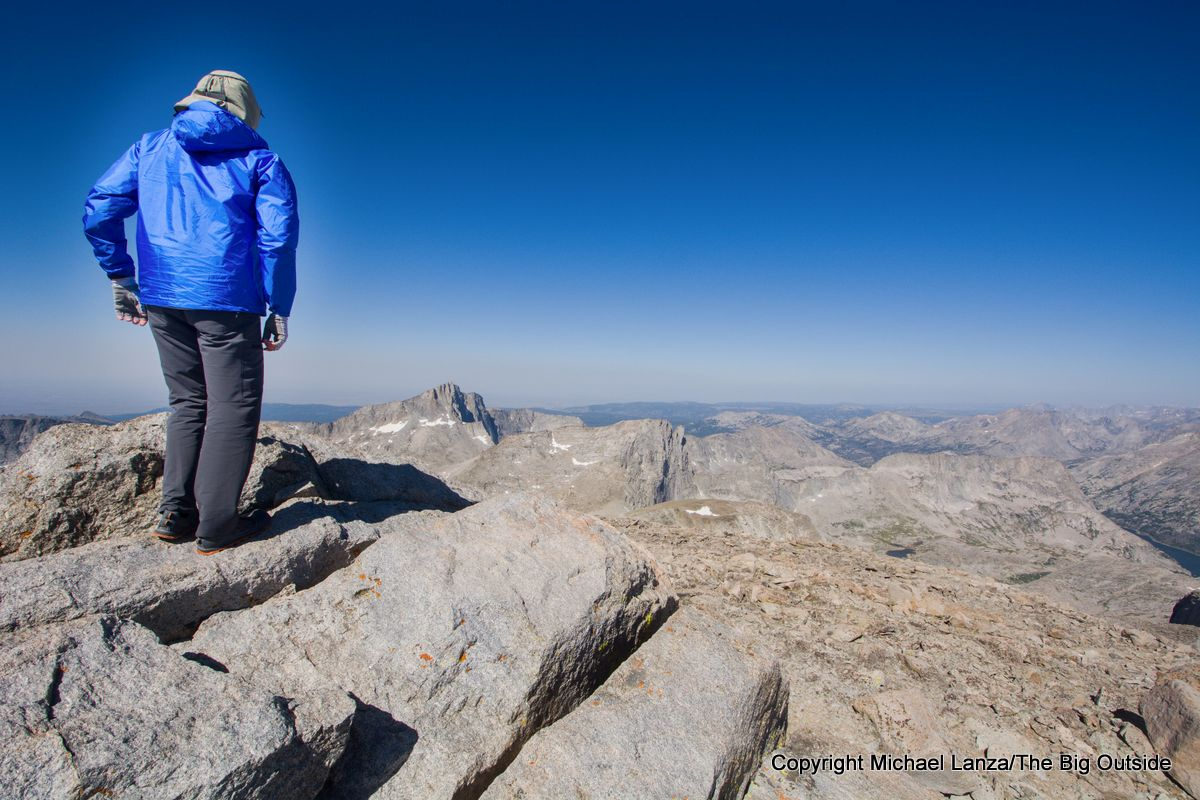 A backpacker on the summit of Wind River Peak on the Wind River High Route.
