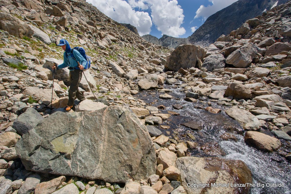 A backpacker hiking in the Alpine Lakes basin on the Wind River High Route.