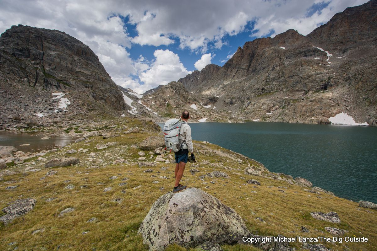 A backpacker in the Alpine Lakes basin on the Wind River High Route.