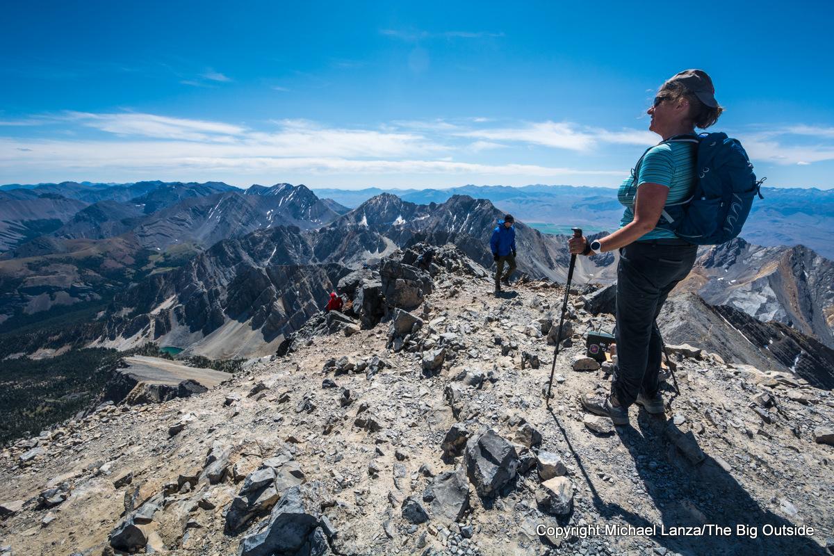 A hiker on the summit of Idaho's 12,662-foot Borah Peak.
