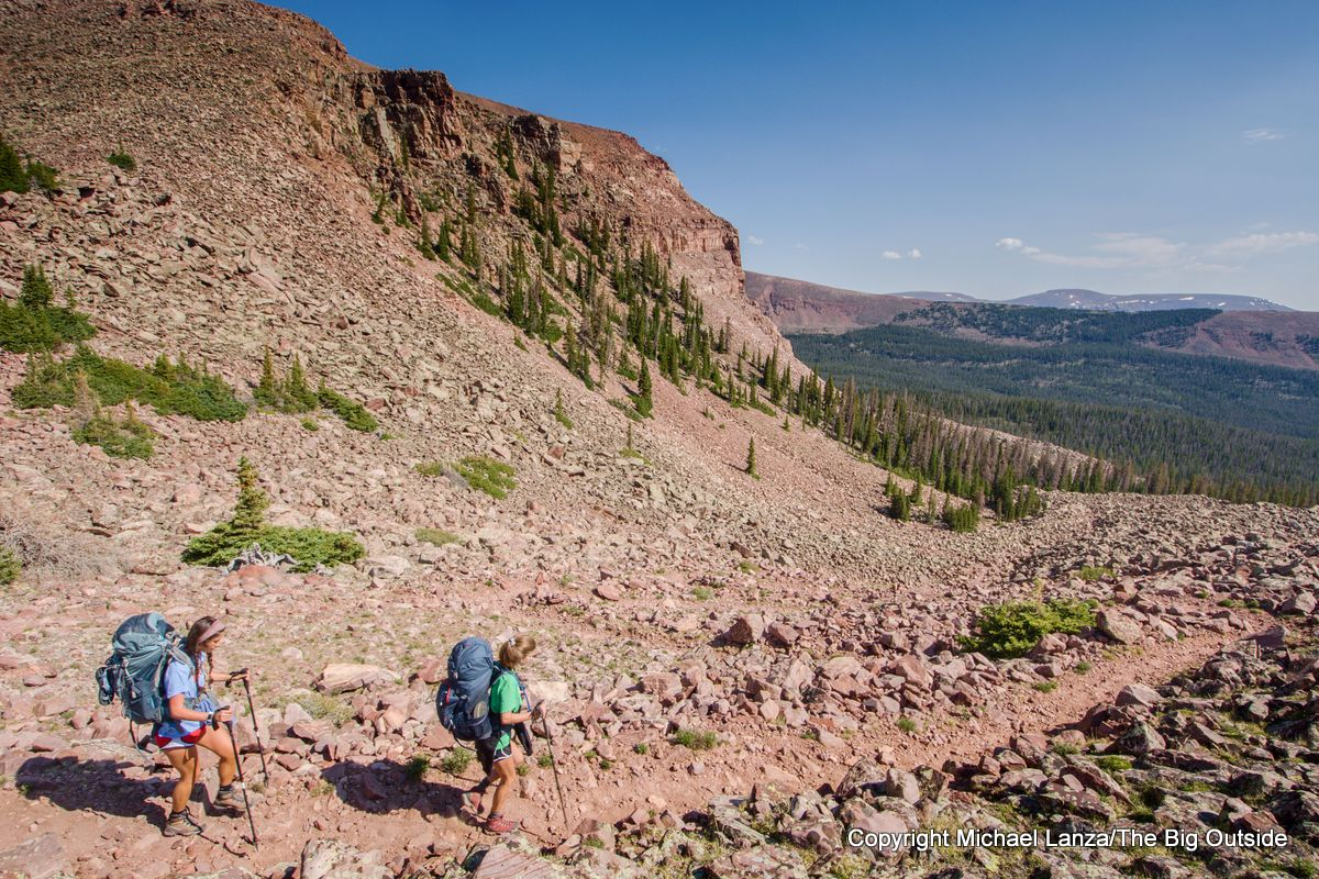 Backpackers on the Chain Lakes Atwood Trail 43 at Roberts Pass, High Uintas Wilderness, Utah.